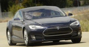 A Tesla Model S electric sedan is driven near the company's factory in Fremont